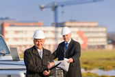 Architect man make notes on construction site — Stock Photo