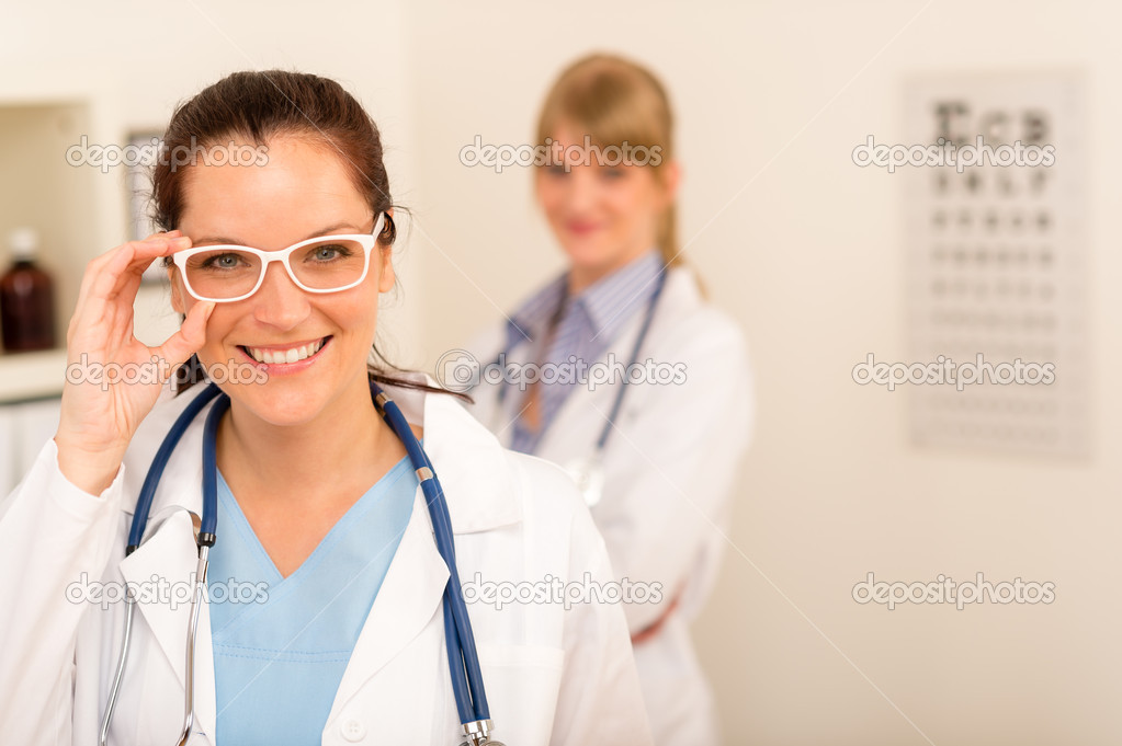 Female doctor ophthalmologist with funny white glasses looking at camera  Stock Photo #10516330