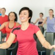 Smiling woman at fitness class gym workout — Stock Photo
