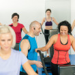 Fitness instructor leading class of alpinning — Stock Photo