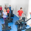 Stock Photo: Class of young adults with fitness trainer