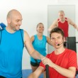 Young fitness instructor lead class alpinning — Stock Photo