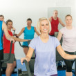 Stock Photo: Fitness young group on elliptical cross trainer