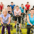 Stock Photo: Spinning class at gym