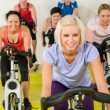 Young woman at spinning class enjoy workout — Stock Photo