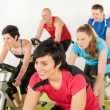 Royalty-Free Stock Photo: Fitness group of on gym bike