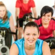 Smiling woman at spinning class fitness workout — Stock Photo