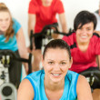 Royalty-Free Stock Photo: Smiling woman at spinning class fitness workout