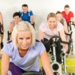 Fitness young woman on gym bike spinning — Stock Photo #10569913