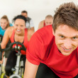 Indoor bicycle cycling in gym — Stock Photo #10569957