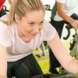 Young woman at bike spinning class - Photo