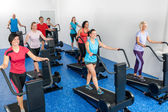 Fitness class walking on treadmill running belt — Stock Photo