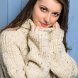Smiling winter brunette woman in beige sweater — Stock Photo