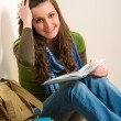 Student teenager woman hold book - Stock Photo