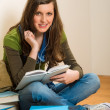 Student teenager woman hold book listen music — Stok fotoğraf