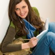 Student teenager woman hold book listen music — Stock Photo #10571058