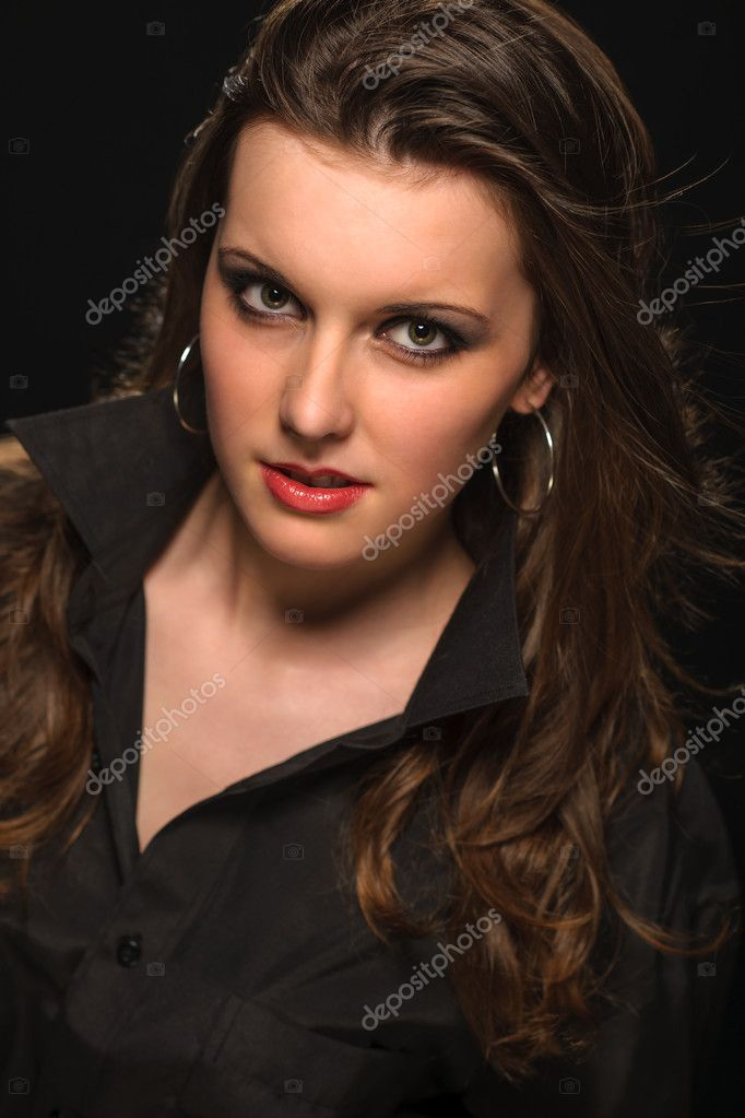 Portrait of young beautiful woman on dark background — Stock Photo #10571080