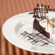 Sacher cake with whipped cream and chocolate — Stock Photo