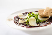 Vegetarian carpaccio with beetroot,nuts and toast — Stock Photo