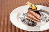 Delicious chocolate cake with physalis — Stock Photo