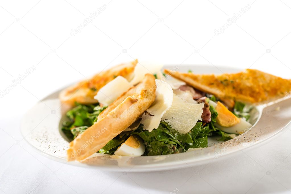 Greek style salad with garlic bread, egg, parmesan and bacon — Stock Photo #10724845