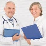Medical doctor team seniors smiling hold folders — Stock Photo #8036613