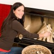 Home fireplace woman put logs happy winter — Stockfoto