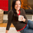 Winter home fireplace woman drink hot coffee — Stock Photo