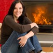 Home fireplace happy woman relax warm up - Stock Photo