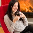 Winter home fireplace woman glass red wine — Stock Photo #8037312