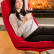 Winter home fireplace woman glass red wine — Stock Photo