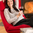 Winter home fireplace woman glass red wine — Stock Photo #8037377