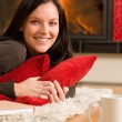 Home living happy woman lying by fireplace — Stock Photo