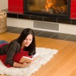 Home fireplace happy woman read book winter — Stockfoto