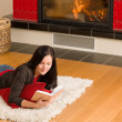 Home fireplace happy woman read book winter — Stock Photo