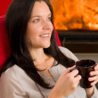 Winter home fireplace woman drink hot coffee — Lizenzfreies Foto