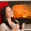 Winter home fireplace womdrink closed eyes — Stok Fotoğraf #8037490
