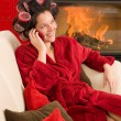 Home beauty woman with hair curlers calling - Photo