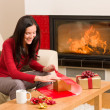 Christmas wrap present happy woman home fireplace — Stock Photo #8037775