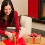 Christmas wrap present happy woman home fireplace — Stock Photo