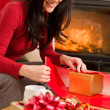 Christmas wrap present happy woman home fireplace — Stock Photo #8037796