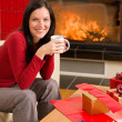 Christmas present wrap woman drink home fireplace — Stock Photo #8037803