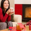 Christmas present wrap woman drink home fireplace — Stock Photo