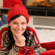 Christmas present woman lying floor home fireplace — Stock Photo