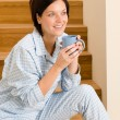Home morning woman in pajamas drink coffee — Stockfoto
