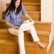 Home living happy woman work laptop staircase — Stock Photo