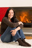Home fireplace happy woman relax warm up — Stok fotoğraf