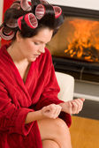 Home beauty woman manicure with hair curlers — Stock Photo
