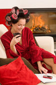 Home beauty woman with hair curlers drink — Stock Photo