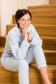 Home morning woman in pajamas on staircase — Stock Photo